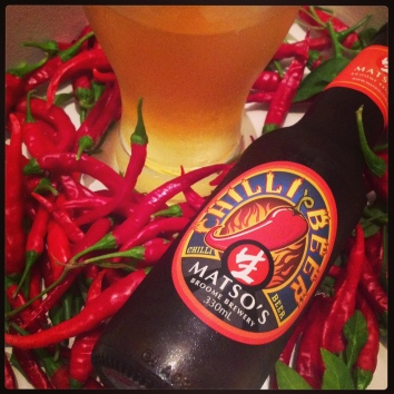 Matso's Chilli Beer 4.2% elegantly posing with some of my home-grown chilli peppers. I've harvested more than 500 chillis off just two plants in less than five months!