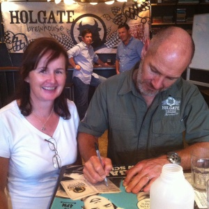 A happy Paul Holgate fan grabs an autograph.
